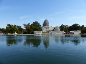 The dome of the Capitol building and the Ulysses S. Grant Memorial under cover